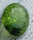1.9 CTs OVAL CUT PERIDOT WITH RARE LUDWIGITE INCLUSION FROM KOHISTAN ,PKISTAN