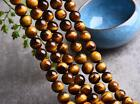 0114     4A Natural Yellow Tiger Eye round beads strand