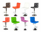 Pair of bar stools in tufted PU leather with chrome base and foot rest