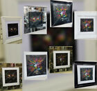 Multi coloured skulls with spikes, liquid art & mirror/black frame pictures.