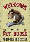 WELCOME TO THE NUT HOUSE WHERE BEING A NUT IS ESSENTIAL - METAL PLAQUE SIGN 677