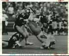 1982 Press Photo Oilers Player Earl Campbell is Dumped by Loren Toews,