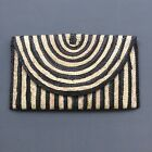 Seagrass lined clutch purse with metal clasp and zip