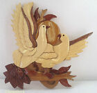 carved wooden doves