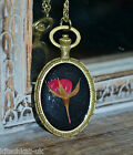 Real Rose Necklace in black resin in oval bronze setting - Flower Jewellery