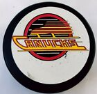 VANCOUVER CANUCKS VINTAGE GENERAL TIRE B24 SLUG NHL MADE IN CANADA GAME PUCK