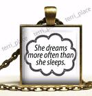 She Dreams More Often Than She Sleeps Girly Glass Top Bronze Pendant Necklace