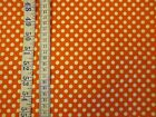Orange fabric with white polka dots 100% cotton from Riley Blake