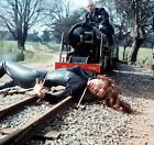 8b20-14058 Diana Rigg in peril tied to the railroad tracks TV The Avengers 8b20- $11.99 USD on eBay
