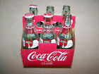 6-PAC OF COKE EMTY BOTTLES - CHRISTMAS 1994 & 1996