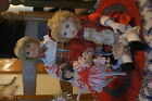 """Three Porcelian Christmas dolls - two 8"""" tall and one 3"""" tall.  Adorable."""