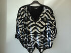 BEAUTIFUL SUDI BLACK AND SILVER 100% SILK, FULLY LINED EVENING TOP.