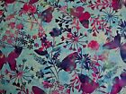 Mariposa Meadow on blue/green background 100% cotton Fabric from Studie E