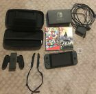 Nintendo Switch Console Bundle - Gray Joy-Cons w/ 64GBs, 2 Games, and Case