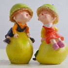 Kissing kids on pears - set of 2 - poly resin figurines