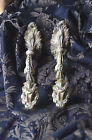 Pair of antique French solid bronze curtain tie backs