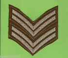 #T55.  PAIR OF TWO BAR  CLOTH PATCHES, TWO  STRIPES ON DARK GREEN  BACKING