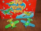 Pull String Planes. 2 colours to choose from.New. CE marked.Boys/Girls