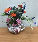 Red Hat Teapot with Artificial Mixed Spring Flowers in a Purple Chintz Teapot
