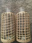 Anthroplogie brand new large cage  seagrass wrapped carafes x 2 pitchers