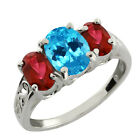 2.60 Ct Oval Swiss Blue Topaz and Red Garnet Sterling Silver Ring