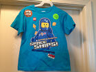 LEGO The Movie Blue Benny Spaceships Glow in Dark Tee Shirt Size 4-16 Brand New