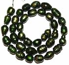 NP316 Emerald Green w Black 8mm - 9mm Cultured Freshwater Rice Pearl Beads