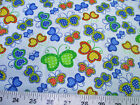 Discount Fabric Cotton Apparel Multi-Colored Butterflies on Light Blue 402K