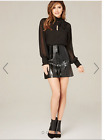 bebe women black mini skirt faux leather and patent straps new w/ tag read