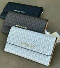 NWT MICHAEL KORS JET SET TRAVEL CARRYALL MK SIGNATURE FLAP WALLET VANILLA BROWN image