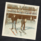 Vintage Photograph Two Young Boys Putting on Snow Skiis